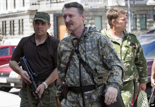 UKRAINE – Igor Girkin also known as Igor Strelkov, a pro-Russian commander, center, arrives for the wedding of platoon commander Arsen Pavlov and Elena Kolenkina in the city of Donetsk, eastern Ukraine. July 11, 2014