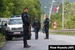 KOSOVO -- Kosovo police special unit members secure the area near the village of Cabra, north western Kosovo, during an ongoing police operation, May 28, 2019