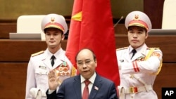 Vietnam's newly elected President Nguyen Xuan Phuc takes an oath in front of the National Assembly in Hanoi on April 5.