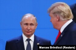 ARGENTINA -- U.S. President Donald Trump and Russian President Vladimir Putin are seen during the G20 leaders summit in Buenos Aires, November 30, 2018.