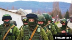 "Russian military forces, referred to as ""Little Green Men,"" in Perevalne, Crimea, March 5, 2014."