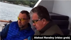 A screen grab of billionaire Oleg Deripaska (left) and Russian Deputy Prime Minister Sergei Prikhodko (R) allegedly on board the business tycoon's yacht.
