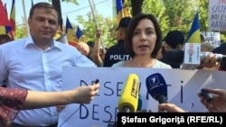 Moldova - Chisinau, protest 'against' and 'in favor' change electoral system. Maia Sandu and Andrei Nastase, two leaders of the opposition parties