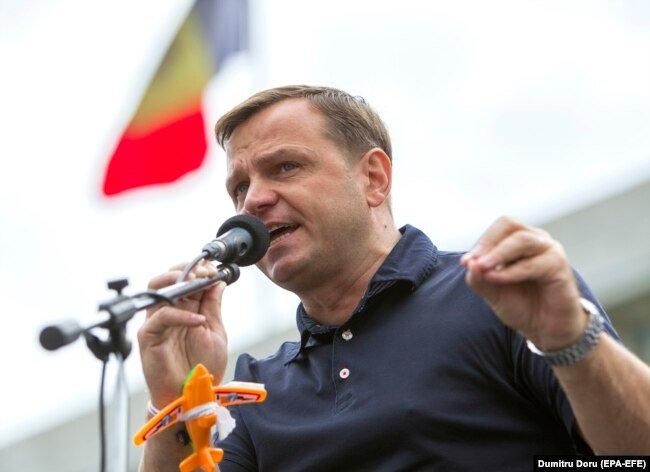 MOLDOVA -- The leader of the Dignity and Truth Platform Andrei Nastase delivers a speech during a protest in Great National Assembly Square, in front of the Government building, after the invalidation of the second round of Mayoral Elections in Chisinau,