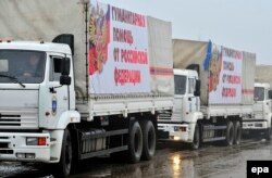 Russia -- Trucks of a Russian aid convoy carrying banners reading 'Humanitarian help from Russian Federation' wait for departure to Ukraine in Rostov region, December 11, 2014.