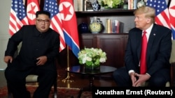 SINGAPORE -- U.S. President Donald Trump and North Korea's leader Kim Jong Un meet in a one-on-one bilateral session at the start of their summit at the Capella Hotel on the resort island of Sentosa, Singapore June 12, 2018