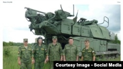 RUSSIA-Russian officers with BUK missile launcher from bellingcat investigation.