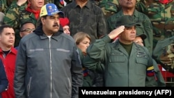 "VENEZUELA -- Venezuelan President Nicolas Maduro (L) and Defence Minister Vladimir Padrino attending a military ceremony to commemorate the ""27th Anniversary of the Military Rebellion of the 4FEB92 and National Dignity Day"", in Caracas, February 4, 2019"