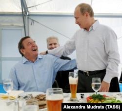 RUSSIA – Vladimir Putin and Gerhard Schroeder, city of Vyborg, Sept. 6, 2011.