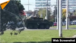 A small NATO convoy moves through a Slovak town