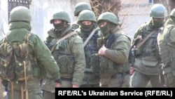 Russian soldiers without insignia on their green uniforms seized control of Crimea in 2014.
