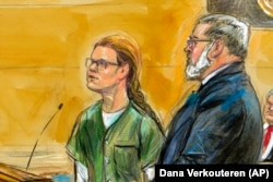 U.S. -- In this courtroom sketch, Maria Butina, left, is shown next to her attorney Robert Driscoll, before U.S. District Judge Tanya Chutkan, during a court hearing at the U.S. District Court in Washington, December 13, 2018