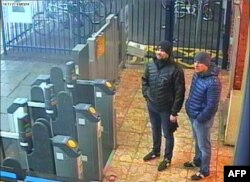 The two Russian men identified by British investigation as suspects in Skripal Poisoning appear in a video recorded by the security cameras in Salisbury metro station.