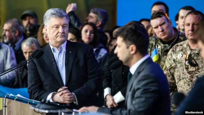 UKRAINE – Ukraine's President and presidential candidate Petro Poroshenko attends a policy debate with his rival, comedian Volodymyr Zelenskiy (R), at the National Sports Complex Olimpiyskiy stadium in Kyiv, on April 19, 2019