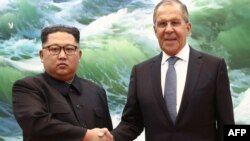 Kim Jong Un Meets Sergei Lavrov. TASS image