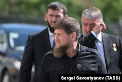 Ramzan Kadyrov (front), Chechen Parliament Chairman Magomed Daudov (L), and State Duma member Adam Delimkhanov (R) arrive for the inauguration of Vladimir Putin as President of Russia on May 7, 2018.