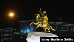 TURKMENISTAN - ASHGABAT, FEBRUARY 14, 2017: A monument to Turkmenistan's President Gurbanguly Berdimuhamedov.