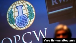 NETHERLANDS -- The logo of the Organization for the Prohibition of Chemical Weapons (OPCW) is seen during a special session in the Hague, Netherlands June 26, 2018