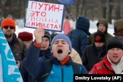 "RUSSIA – The protester's sign reads, ""Putin is War and Poverty!"" St.Petersburg, Feb. 6, 2016"