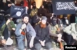 Syria - A still image taken on July 14, 2016 from an undated video posted on social media, shows Islamic State senior operative Abu Omar al-Shishani (C) sitting with fighters in an unknown location