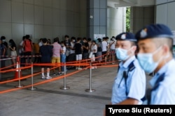 Supporters of Tong Ying-kit, the first person charged under the new National Security Law, line up to attend the hearing at the High Court on July 30, 2021.