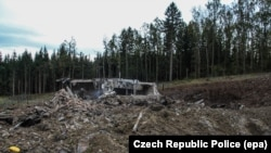 A photo provided by the Police of the Czech Republic shows a damaged private ammunition depot near Vrbetice, eastern Moravia, December 11, 2014.