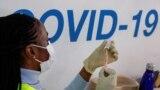 FILE PHOTO: A dose of AstraZeneca vaccine is prepared at COVID-19 vaccination center in the Odeon Luxe Cinema in Maidstone, Britain February 10, 2021.