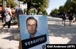 "GERMANY -- A poster with a picture of Russian opposition leader Aleksei Navalny captioned ""poisoned"" is seen outside the Russian embassy on Unter den Linden in Berlin, Sept. 23, 2020."