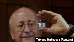 Alexander Gintsburg, director of the Gamaleya National Research Center for Epidemiology and Microbiology, shows bottles with Sputnik-V vaccine against the coronavirus disease (COVID-19) during an interview with Reuters in Moscow, Russia September 24, 2020.