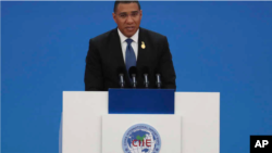 Jamaica's Prime Minister Andrew Holness delivers a speech at the opening ceremony of the China International Import Expo in Shanghai on Tuesday, Nov. 5, 2019.