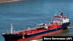 The ship that would later become the Asphalt Princess sails through Quebec City, Canada, on June 14, 2012. (Steve Geronazzo via AP)