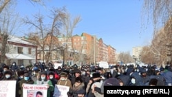 "At a rally in Uralsk, a protester holds a poster saying, ""Nazarbayev is a dictator"" on February 28, 2021."