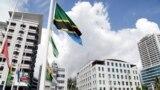 FILE PHOTO: Various flags fly at half mast following the death of Tanzania's President John Magufuli in Dar es Salaam, Tanzania March 18, 2021. REUTERS/Emmanuel Herman/File Photo