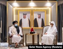 Qatar's Foreign Minister Mohammed bin Abdulrahman Al Thani (right) meets with Mullah Abdul Ghani Baradar, head of the Taliban's political bureau, in Doha on August 17, 2021. (Qatar/Reuters)