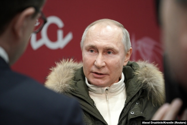 Russian President Vladimir Putin speaks with journalists as he attends a concert marking the seventh anniversary of Russia's annexation of Crimea at Luzhniki Stadium in Moscow on March 18, 2021.