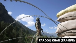 An Indian paramilitary soldier stands guard at a check post along a highway leading to Ladakh, at Gagangeer, some 81 kilometers from Srinagar, the summer capital of Indian Kashmir, on June 17, 2020.