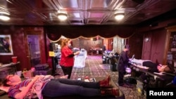 People donate blood at a Red Cross blood drive at The Magic Castle during the outbreak of the coronavirus disease (COVID-19), in Los Angeles, California, U.S., February 11, 2021. REUTERS/Mario Anzuoni
