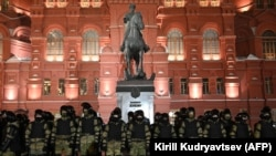 Law enforcement officers stand guard in front of a monument to Soviet Marshal Georgy Zhukov outside Red Square in Moscow, Russia on Feb. 2, 2021.