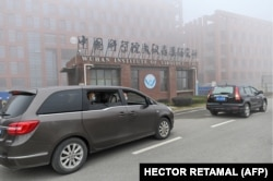 Members of the WHO team investigating the origins of the COVID-19 arrive at the Wuhan Institute of Virology on February 3, 2021.