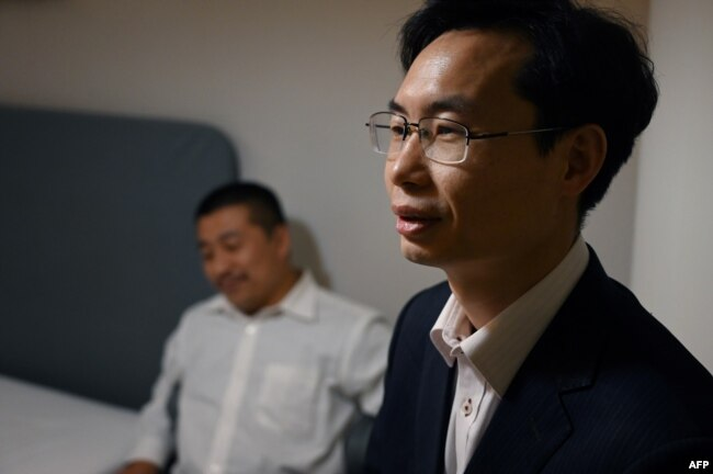 Lawyers Zhang Keke (R) and Ren Quanniu, representing Chinese citizen journalist Zhang Zhan, in Shanghai, China on December 27, 2020.