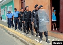 On July 8, 2019, riot police officers stand near the church in Jinotepe, where a religious service was held for demonstrators who died during 2018 protests against Nicaraguan President Daniel Ortega's government. (Oswaldo Rivas/Reuters)