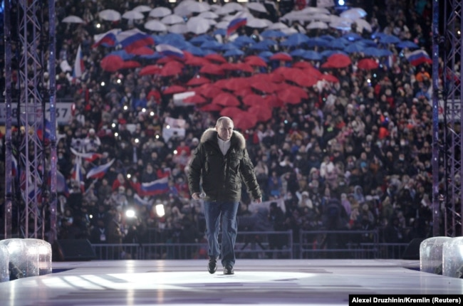 Russian President Vladimir Putin attends a concert marking the seventh anniversary of Russia's annexation of Crimea at Luzhniki Stadium in Moscow, Russia on March 18, 2021.