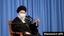 IRAN – Supreme Leader Ayatollah Ali Khamenei speaks in a meeting with the family of Revolutionary Guard Gen. Qasem Soleimani, who was killed in a U.S. drone strike in Baghdad in early 2020, in Tehran, December 16, 2020.