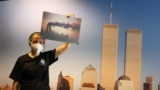 Docent Joan Mastropaolo shares her first-person account of the September 11, 2001, attacks with students during a tour at the 9/11 Tribute Museum in New York City, August 26, 2021. (REUTERS/Caitlin Ochs)